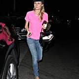 Diane Kruger carried a Louis Vuitton wallet.