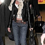 Jennifer wore a leather jacket with cuffed boyfriend jeans and a Louis Vuitton monogrammed scarf when she touched down in London in 2010.