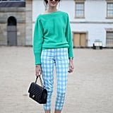 We're in love with her cropped gingham pants and sweatshirt pairing.