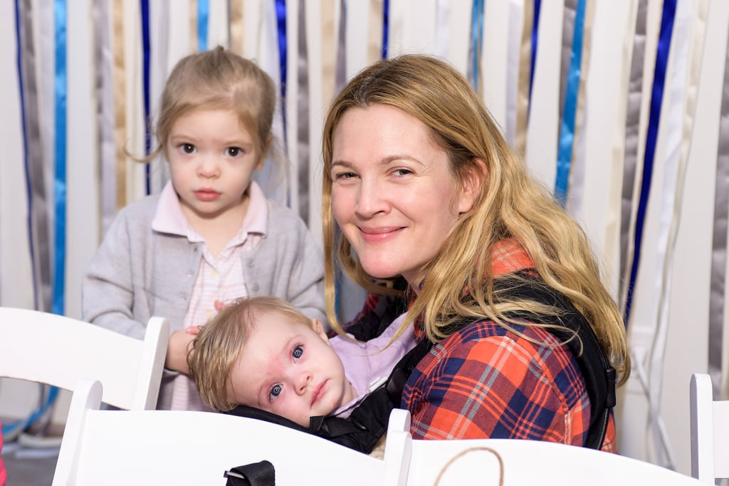 Drew Barrymore has been a Hollywood mainstay since she was a baby — and has seemed to live about a million lives since then — which is why it's so heartwarming to see her settle into the role of mother. Drew married art adviser Will Kopelman in June 2012, three months before the couple welcomed their first daughter, Olive. Their second baby girl, Frankie, was born in April 2014, and the little ones quickly started to bear a resemblance to their famous mom — seriously, Olive is almost identical to a young Drew in her E.T. the Extra-Terrestrial days. While Drew and Will have since split, the actress has given us a few peeks at Frankie and Olive on social media, at charity events, and in People magazine. We've rounded up some of Drew's most adorable moments with her kids; keep reading to see them all now, then check out our recent interview with her, where she talks life, love, and Rosé.