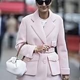 A sharp jacket and geometric bag take a denim mini to new heights.