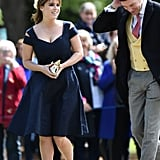For Pippa Middleton and James Matthews's nuptials in May 2017, Eugenie chose a navy blue fit-and-flare by Paule Ka that she coordinated with colourblock Zara heels and a pillbox hat.
