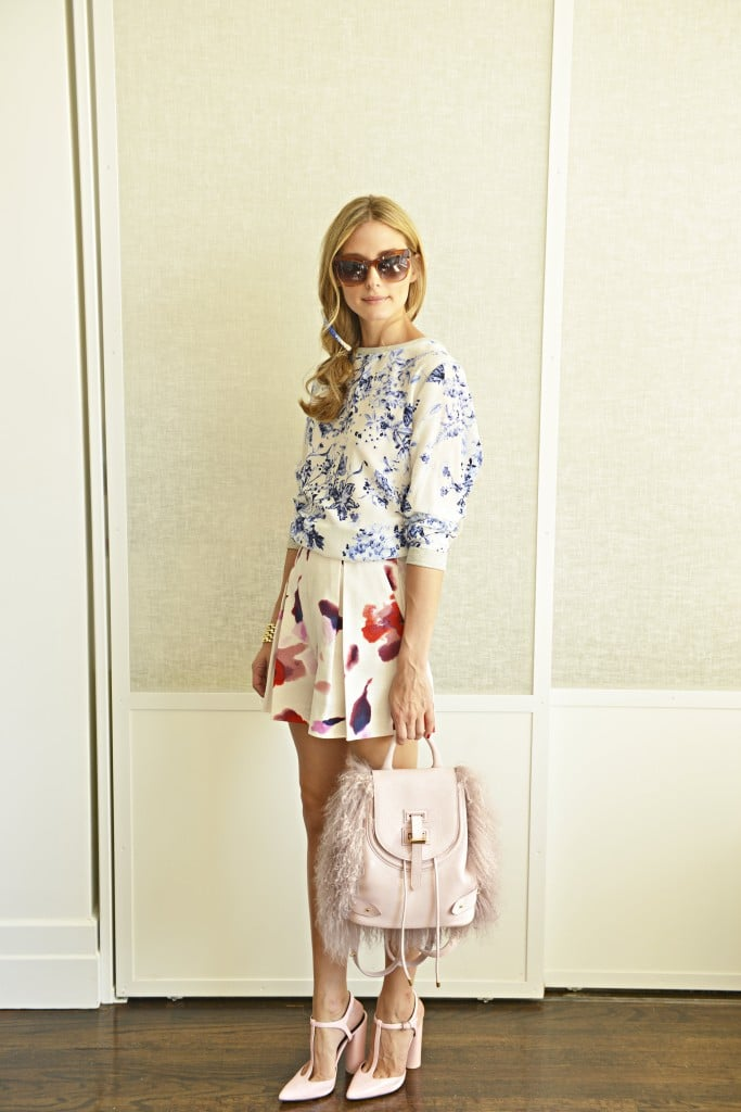 To prove again that different patterns can work in the same color schemes, Olivia topped a pair of pink watercolor-printed shorts with a soft-blue floral top. She carried the pink hues through the rest of the outfit with her Meli Melo backpack and pastel heels.  Source: Olivia Palermo