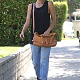 Gwen Stefani paired cuffed jeans with ankle boots.
