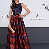 Louise Roe embraced a voluminous silhouette in a colorful printed Randa Salamoun gown and gold add-ons.