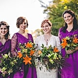 These three bridesmaids wore bright purple dresses with lace sleeves.