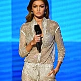 Gigi Hadid Wearing Her Versace Jumpsuit on Stage at the AMAs