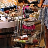 Suri Cruise looked at seafood at Whole Foods in NYC.