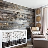 A wood plank accent wall endows this nursery with a serious dose of rustic elegance.