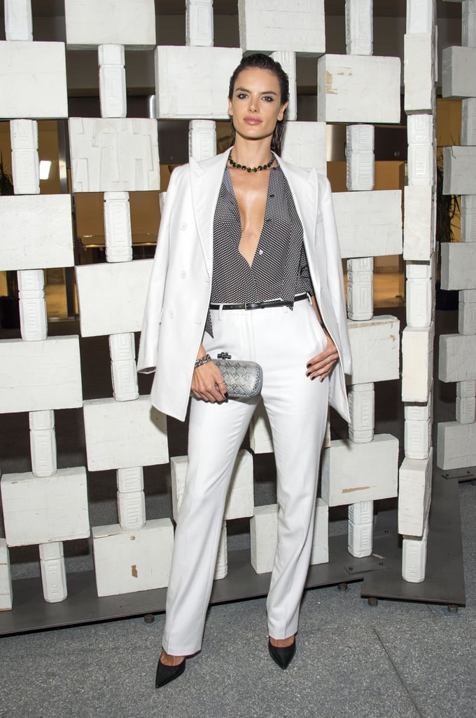 """Sometimes you have to deviate from the norm on the red carpet. Aware of this fact, Brazilian Victoria's Secret Angel Alessandra Ambrosio traded her usual formfitting gowns for a white pantsuit at the 2016 Hammer Museum Gala in Los Angeles.   The model, who owns her own fashion line, Ále by Alessandra, paired her white Bottega Veneta high-waisted trousers and blazer with a tucked-in blouse — featuring one seriously plunging neckline — and striking black and silver accessories. To make things even edgier, Alessandra went with a """"wet"""" hair look and smoked-out makeup, creating a smoldering look that was a new kind of chic for the star. Keep scrolling to see more pictures of Alessandra's stunning outfit. Then, admire her recent adventures at Paris Fashion Week.      Related:                                                                Alessandra Ambrosio's Red Carpet Style Got Better and Better as the Year Went By                                                                   39 Times Alessandra Ambrosio's Airport Style Had That Model-Off-Duty Look                                                                   100+ Looks That Made Alessandra Ambrosio 2016's Queen of Street Style"""