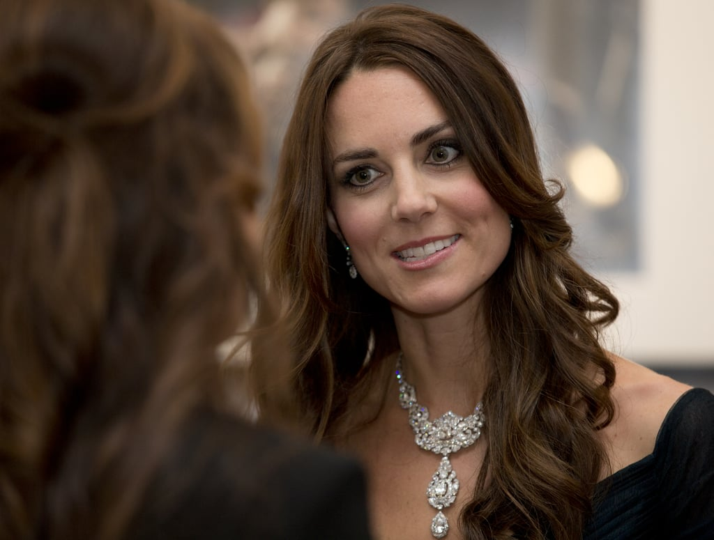 "Kate's New Look It's no secret that Queen Elizabeth II requested that Kate be given a royal makeover leading up to the duke and duchess's trip abroad. The new look will include having Kate sport more royal jewels (mostly borrowed from the queen's personal stash) and longer, weighted hemlines to avoid more ""Marilyn moments"" like the one Kate experienced when she was visiting Canada.  Unfortunately, the family's trip won't include many formal galas (they aren't really the ball types anyway), so we probably won't see that many tiaras or blinged-out necklaces, but we can expect to see Kate sporting a much more mature, conservative wardrobe. Hopefully, however, this doesn't mean that Kate and William won't be able to slip into some jeans like they did in Canada! The Entourage Kate and William will be taking their largest entourage ever (11 total) for their royal tour. The list includes William's private secretary, Miguel Head; Kate's private secretary, Rebecca Deacon; three press officers, Ed Perkins, Nick Loughran, and Katrina McKeever; an orderly; Kate's hairdresser; the couple's adviser, David Manning; a personal assistant; an extra secretary; and, of course, the nanny. While the entourage may sound large, it's actually pretty small compared to other royal tours, as Prince Charles typically takes along a staff of 14, and the queen regularly travels with several ladies in waiting in addition to the big group of secretaries, press officers, and the like. Want more? Check out our breakdown of the big moments to watch out for in the coming month and a history of royal tours over the years. Source: Getty / Alastair Grant / WPA Pool"