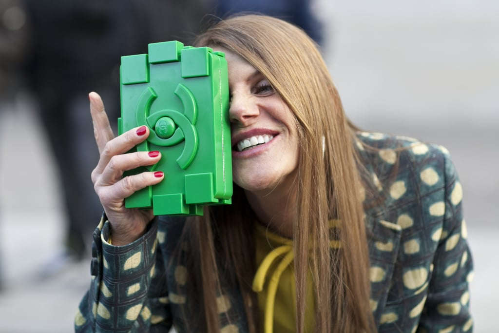 Anna Dello Russo got silly for the camera with her green Chanel clutch.