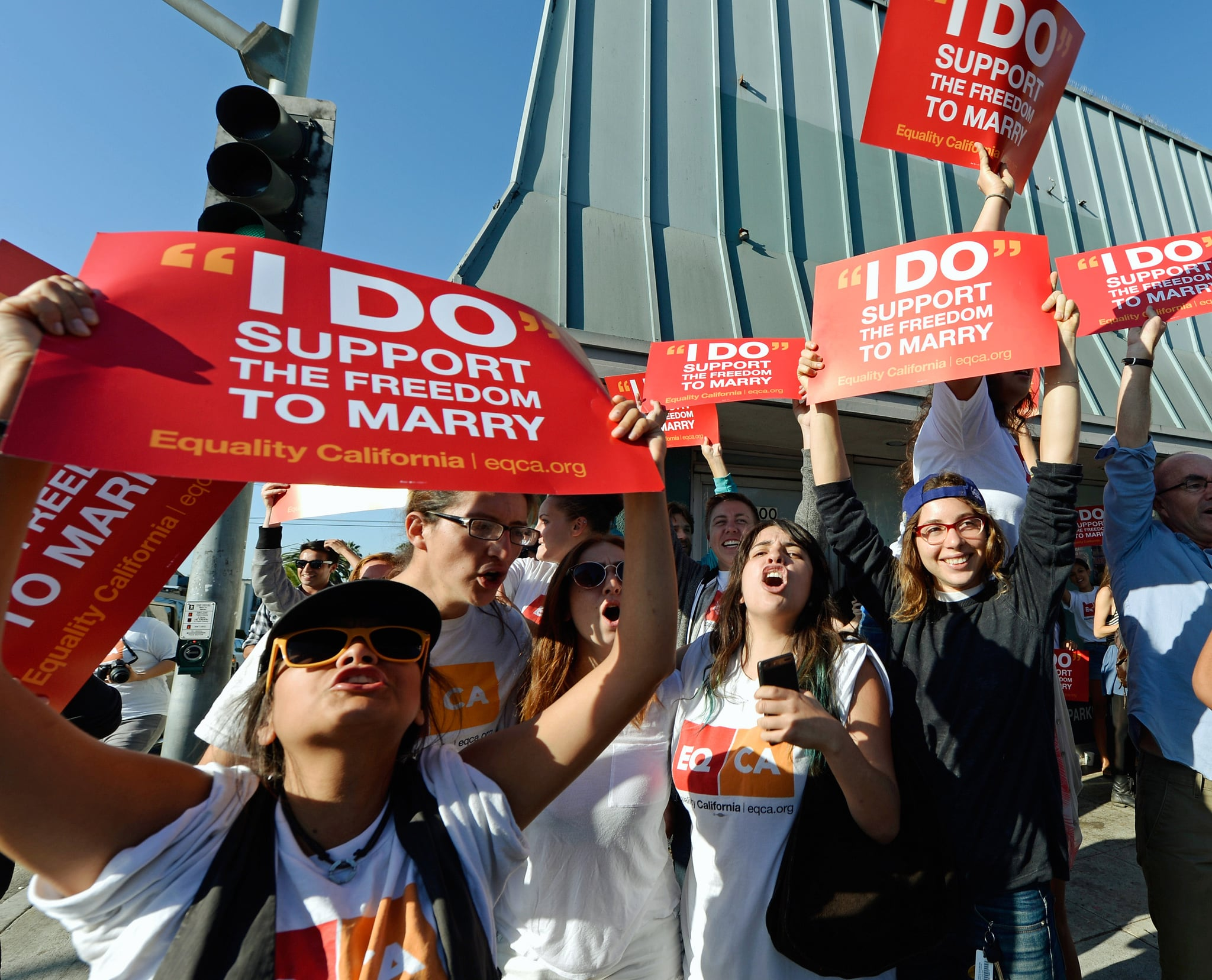 Activists in LA waved signs on Wednesday.