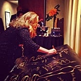 """Adele stepped up to sign the winners poster after being awarded best song for """"Skyfall.""""  Source: Instagram user theacademy"""