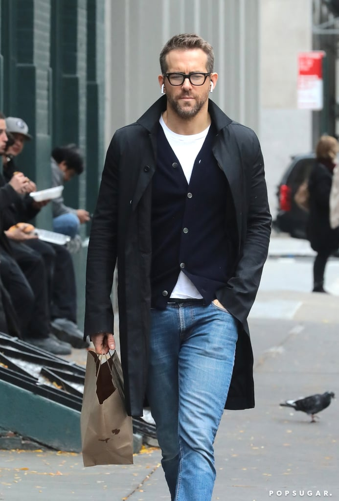 """Ryan Reynolds stepped out on Monday looking good-with-a-capital-G while grabbing takeout food in NYC. The 41-year-old Deadpool star kept things casual in jeans, sneakers, and a sweater, but still managed to look like a runway model thanks to his thick-rimmed glasses and sleek coat. Ryan held on to a bag and kept his Apple Airpods in as he made his way down the street.   The same day as his hunky city outing, Ryan roasted his wife, Blake Lively, on Instagram. Blake is currently filming the spy thriller Rhythm Section in Ireland, and has been looking less-than-glamorous in photos from the set; Ryan poked fun at her by posting one of the offending snaps to his feed, writing, """"#nofilter."""" We can't wait to see how Blake gets him back for that one.      Related:                                                                                                           Ryan Reynolds Roasts Wife Blake Lively and Her Less-Than-Flattering Look on Set"""