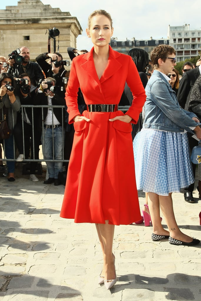Leelee Sobieski strutted in a red coat dress, part of Christian Dior's Fall 2012 Couture line, at Paris Fashion Week.