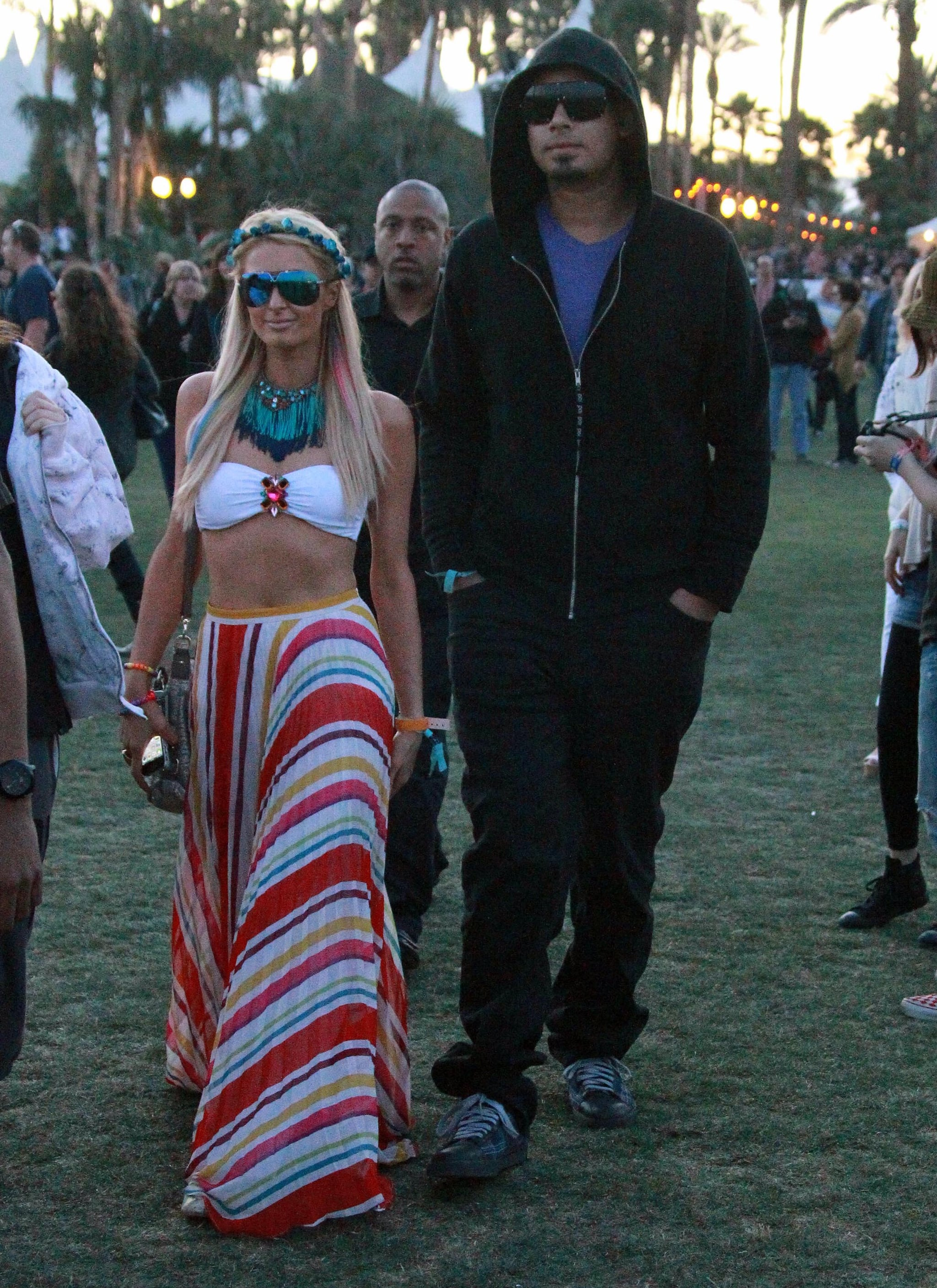 Paris Hilton and her boyfriend, DJ Afrojack, hung out at Coachella on Saturday before partying at Neon Carnival late into the night.