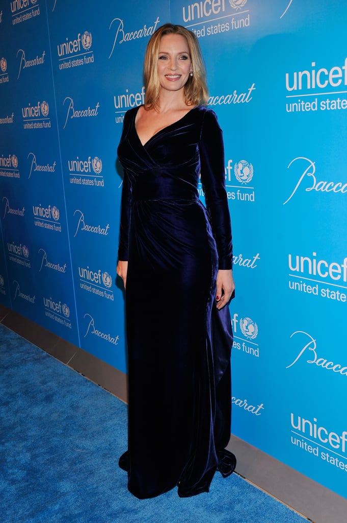 Uma Thurman stepped out in a velvet Atelier Versace that clung to her curves.