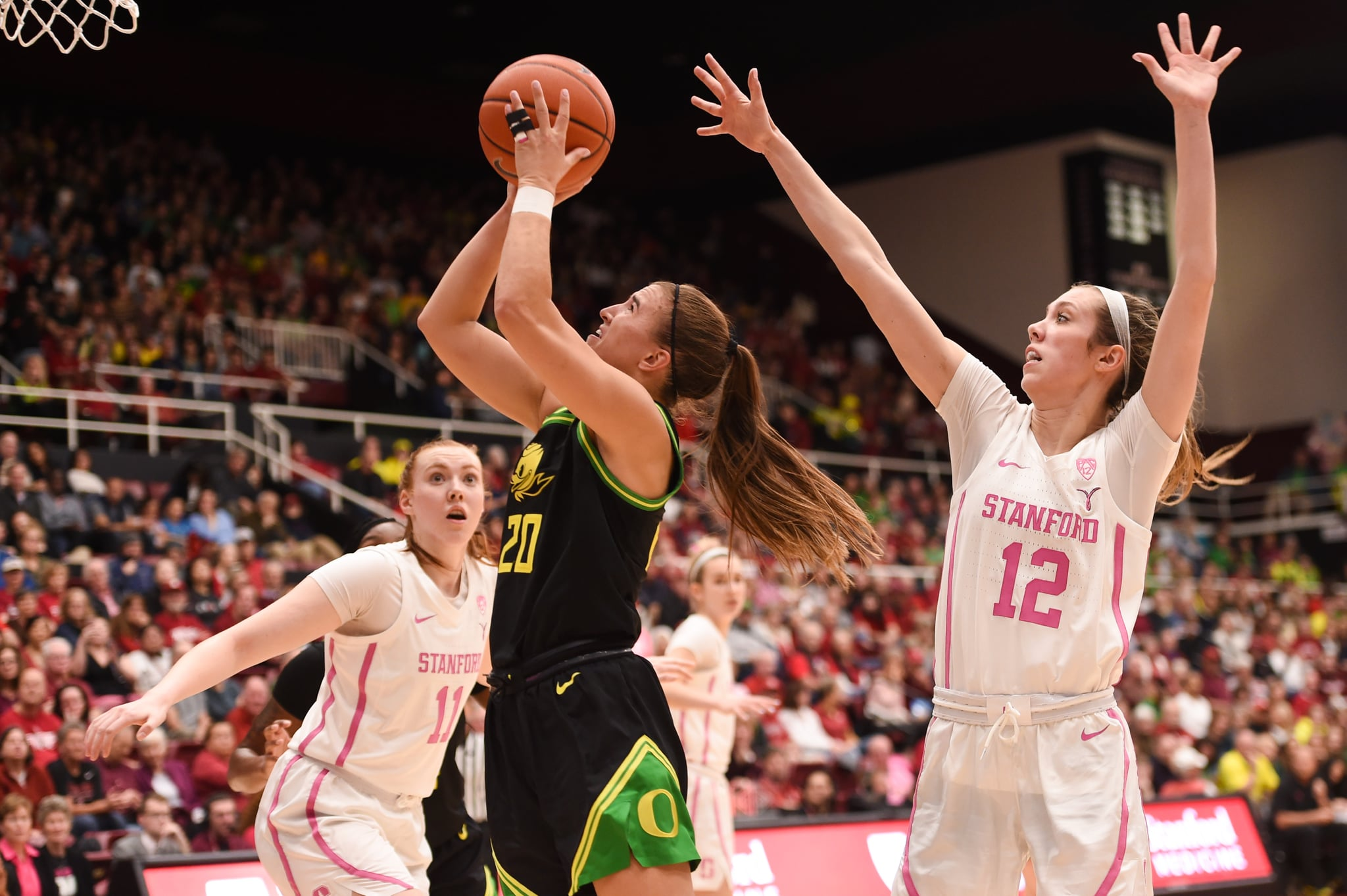 PALO ALTO, CA - FEBRUARY 24: Oregon Ducks guard Sabrina Ionescu (20) shoots over Stanford Cardinal guard Lexie Hull (12) during the NCAA women's basketball game between the Oregon Ducks and the Stanford Cardinal at Maples Pavilion on February 24, 2020 in Palo Alto, CA. (Photo by Cody Glenn/Icon Sportswire via Getty Images)