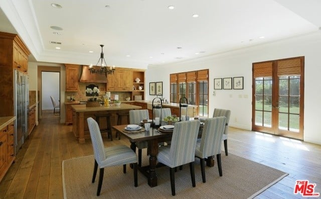 An open floor plan connects the kitchen to the breakfast area and ...