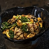 Oven-roasted Tip-Yip, or roasted chicken with mixed greens, roasted vegetables, quinoa, and pumpkin seeds coated in a creamy green curry ranch dressing, can be found at Docking Bay 7 Food and Cargo.