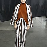 The style star suited up in a striped Smythe suit at the Sally LaPointe show.
