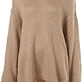 Ah, Fall, the ideal time to cozy up to fuzzy sweaters. This Topshop Knitted Slouchy Cocoon Jumper ($80) will go with everything from jeans to trousers to leggings.