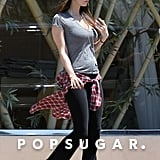 Megan Fox wore a fitted top to show off her belly.