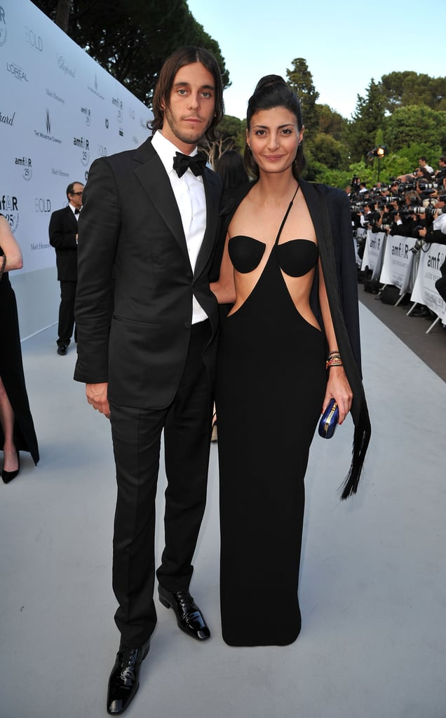 >> Couture and Roitfelds galore populated last night's amfAR's Cinema Against AIDS Gala, held as part of the Cannes festivities at Hotel du Cap-Eden-Roc in Cap d'Antibes. Julia Restoin-Roitfeld, Vladimir Restoin-Roitfeld and their significant others (Robert Konjic and Giovanna Battaglia, respectively) were hosted by Peter Dundas at the Emilio Pucci table, while Carine Roitfeld — and Naomi Campbell, Dasha Zhukova, Kristen McMenamy, and Courtney Love — came decked out in Givenchy. Chanel, too, dressed a host of ladies for the event — including Charlotte Casiraghi, Kirsten Dunst, and Karolina Kurkova — which set a new record, raising more than $10 million for AIDS research (the cost per plate was reportedly $10,000, after all).