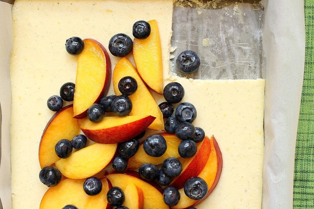 Ricotta Cheesecake Bars Topped with Peaches and Blueberries