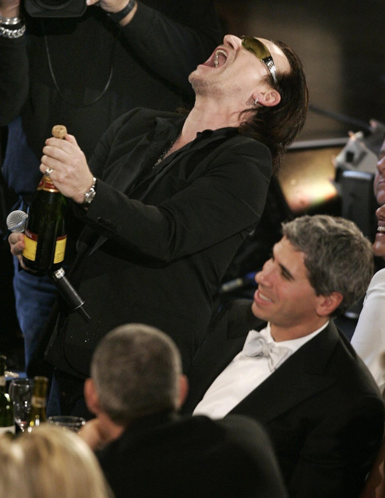 Bono was on fire while popping a bottle of bubbly in NYC in March 2005.