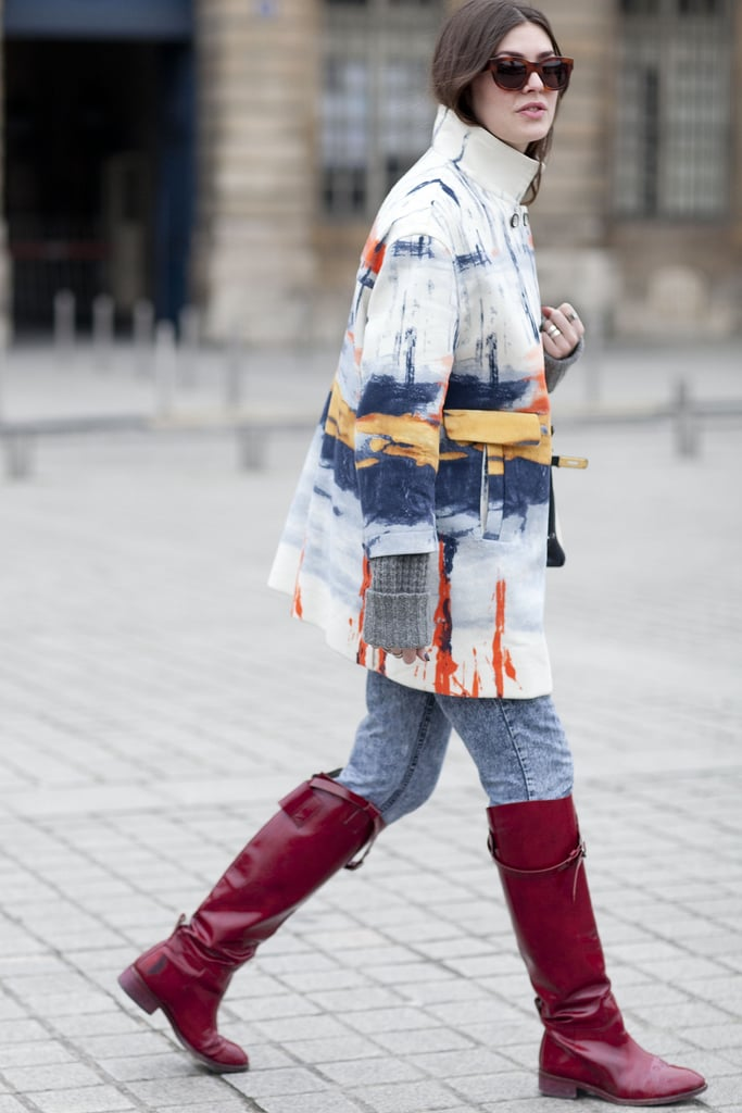 An abstract-print coat gave her denim and boots an artistic edge.