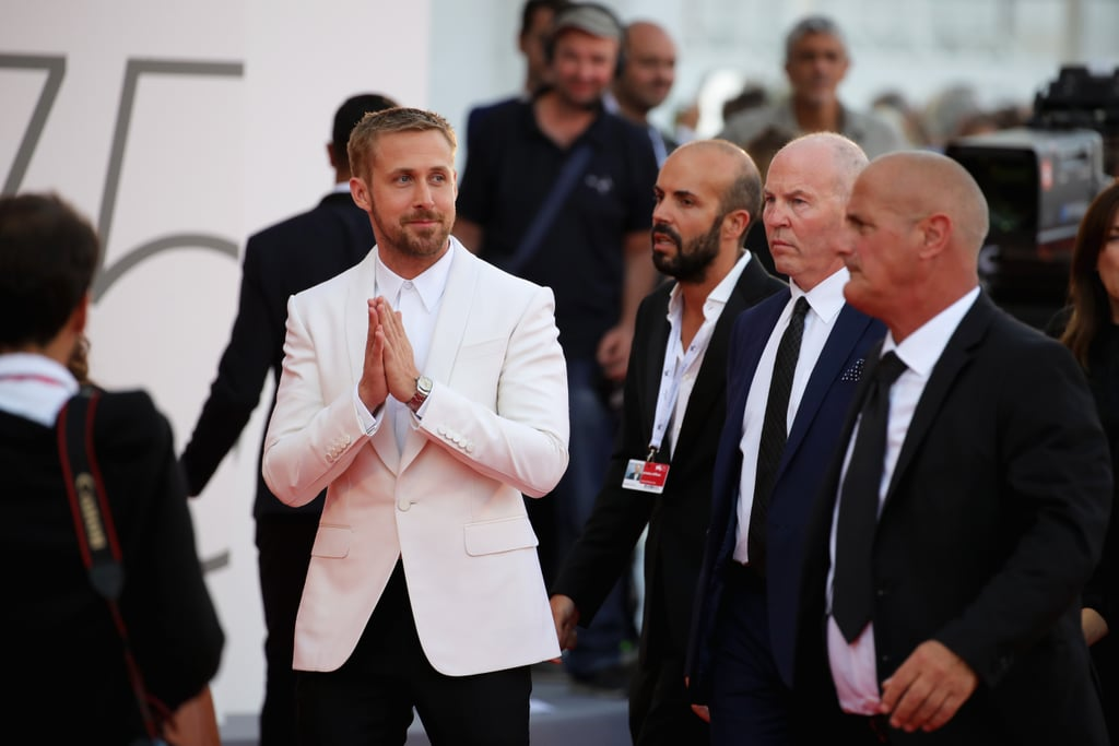 For anyone anxious that they hadn't seen a Ryan Gosling appearance in far too long, now is the time to relax. The Blade Runner 2049 actor just arrived at the Venice Film Festival to promote his new film First Man (and ease your stress, no doubt), and let's just say the appearance was worth the wait. The actor looked suave in a burgundy suit and sunglasses on Wednesday, playfully outshining his costars Olivia Hamilton, Claire Foy, and Jason Clark. He later changed into a white for the opening ceremony.  Joining forces with La La Land writer and director Damien Chazelle once again, Ryan takes on the role of Neil Armstrong in First Man, circling the astronaut's extraordinary life and legendary space mission. Now inhale deeply, and read on for all the therapy you need before the film hits theatres on Oct. 12.      Related:                                                                                                                                Ryan Gosling and Jimmy Kimmel Tried Being Astronauts Together — We Can't Stop Giggling