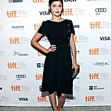 Audrey Tautou's sleek black cocktail dress looked cool with its gold button detailing along the side.