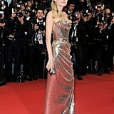 Diane Kruger wore a gold Vivienne Westwood gown to the premiere of Amour.