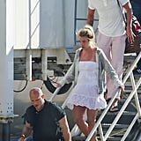 Britney Spears and Jason Trawick get off a plane.