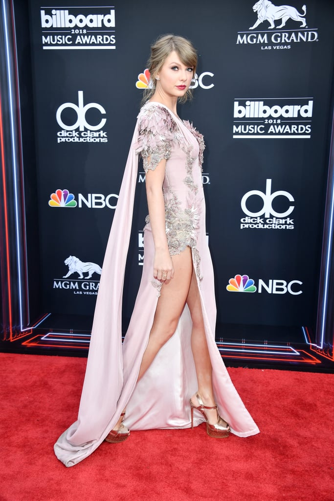 "She's backkk! On Sunday, Taylor Swift surprised everyone by attending the Billboard Music Awards in Las Vegas, marking her first red carpet since 2016. Wearing a gorgeous lavender dress, Tay gave a sly smile as she posed for the cameras. Even though the ""Delicate"" singer has been keeping out of the spotlight in recent years, she's certainly been keeping busy. Aside from releasing her sixth studio album, Reputation, last year, she is currently selling out stadiums with her Reputation tour.  Taylor is up for a handful of awards, including top artist, but we're secretly hoping she'll grace us with a performance. Seeing that Taylor's opening act Camila Cabello is set to perform during the show, maybe they'll do a surprise duet! See more pictures from her red carpet appearance below."
