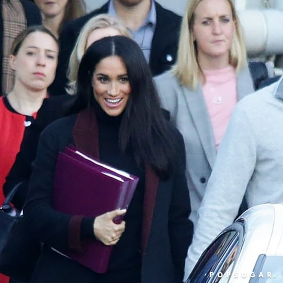 Meghan Markle's Black Coat With Maroon Trim October 2018