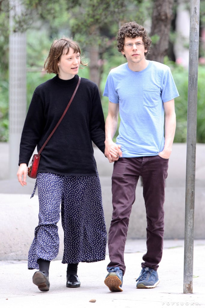 Jesse Eisenberg and Mia Wasikowska held hands.