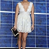Jennifer Lopez arrived at Chanel in a lacy LWD, by none other than Chanel, with one of the label's quilted clutches in hand. Her Tom Ford double ankle-strap pumps finished the look.