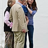 Kate smiled at her father-in-law while holding Prince George in 2015.