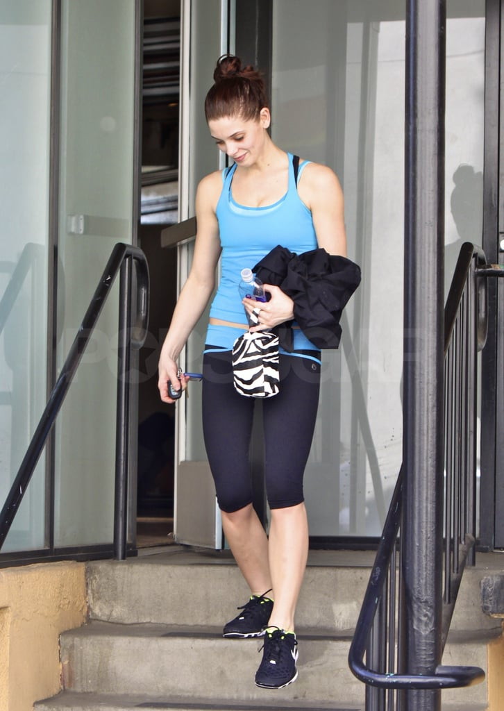 """Ashley Greene left the gym laughing and chatting with a friend after an intense workout in LA today. The birthday girl celebrated her 24th in Las Vegas last weekend, and now she's back to following the strict fitness schedule Tracy Anderson personally choreographed for her. Ashley's been absent from the red carpets this award season, but at least one Twilight star may be on hand this weekend at the Oscars. According to show producer Bruce Cohen, """"if you are a Twilight fan . . . For all of you Twi-Hards out there, we have a little surprise for you in our show on Sunday night . . . if you like those three films, I have three words for you: watch the Oscars."""" We'll be broadcasting LIVE from the red carpet so follow us on Twitter for breaking news and photos, and don't forget we're also giving away a Samsung TV, so be sure to fill out BuzzSugar's ballot for your chance to win!"""