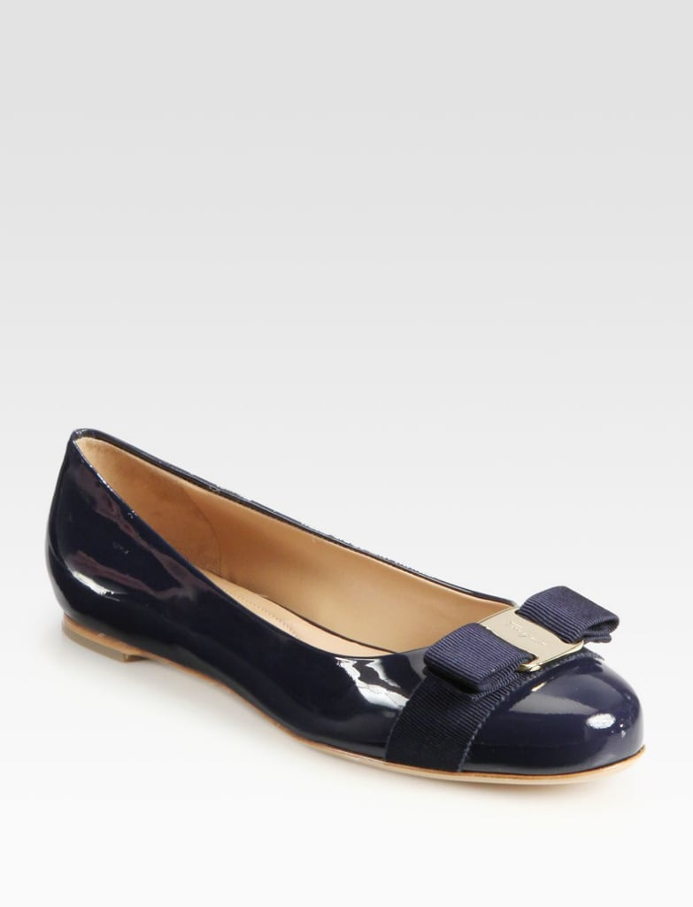Card-carrying members of the workforce aren't required to wear heels every day. A polished ballet flat like Ferragamo's iconic Varina ($450) are a smart substitute she'll love; take it one step further by customizing a pair.