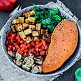 Tofu, spinach, mushrooms, bell peppers, and baked sweet potato
