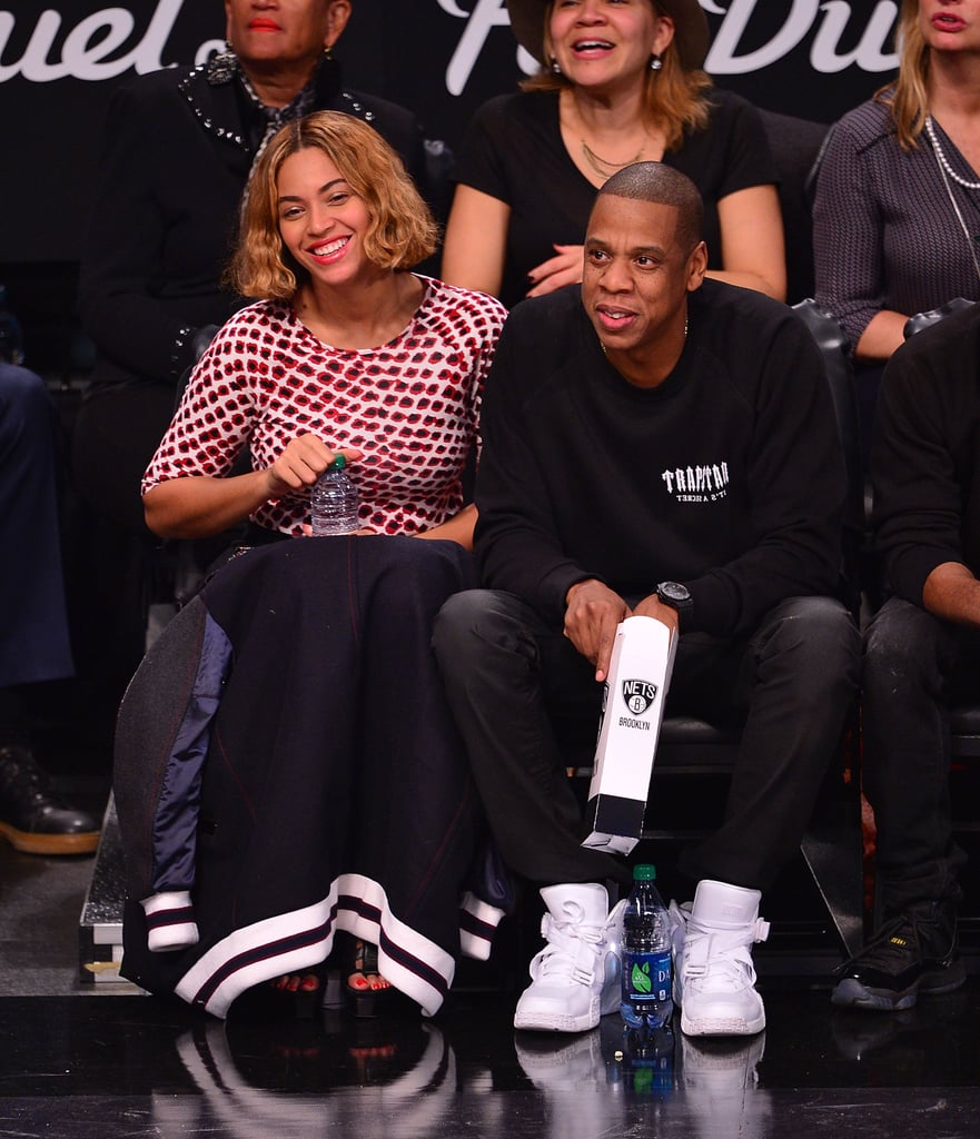 """Beyoncé and Jay Z had a rare date night on Monday when they dropped by a Brooklyn Nets game in NYC. The superstar couple munched on popcorn while sitting in their courtside seats to watch the Nets face off against the Oklahoma City Thunder. Bey and Jay kept things low-key after they spent the weekend celebrating Halloween in the Big Apple. On Thursday, Beyoncé and Jay took Blue Ivy Carter to a costume bash, with Bey and Blue wearing Jackson family-inspired looks and Jay wearing a Michael Myers mask. However, on Friday, the couple took an arty approach to their All Hallows' Eve ensembles when they visited a private party on the spooky night. Bey dressed up as Mexican artist Frida Khalo, while Jay donned a wig to disguise himself into American artist Jean-Michel Basquiat. In other Bey news, the singer has confirmed reports that she will be releasing new music this month when she debuts a box set for Beyoncé, featuring remixes and two new tracks, """"7/11"""" and """"Ring Off."""""""