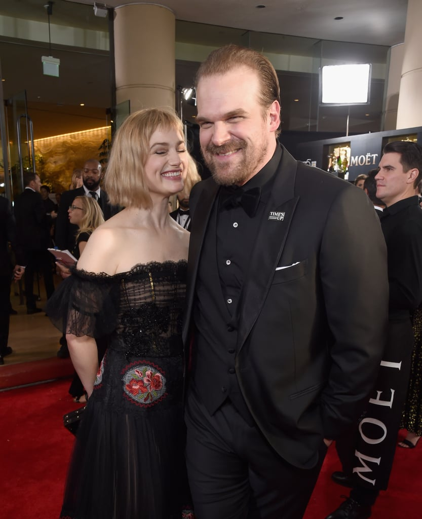 There were tons of celebrity couples who turned the Golden Globes into their own personal date night on Sunday, but one couple who caught our eye in particular was David Harbour and Alison Sudol. OK, technically they haven't officially confirmed that they're together yet, but the pictures pretty much speak for themselves. Not only did the Fantastic Beasts and Where to Find Them actress accompany the Stranger Things actor on the red carpet, but the two could not stop giggling and giving each other heart eyes throughout the night. To top things off, Queenie and Jim Hopper — er, Alison and David — popped up at Netflix's Golden Globes afterparty together, and let's just say they looked pretty cozy. Not to mention, they also attended the annual BAFTA Tea Party in LA just the day before. Hmm . . .  While not much is known about Alison's love life, David was last linked to Julia Stiles in 2012. We guess only time will tell if these two are the real deal.
