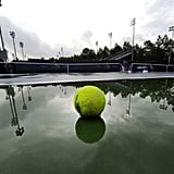 A rain-drenched court in New York sits empty as the US Open's qualifying rounds were canceled ahead of the arrival of Hurricane Irene.