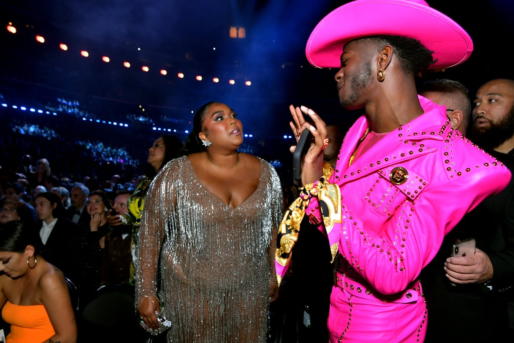 "In addition to its rousing performances and acceptance speeches, the Grammy Awards must also be a great place to gossip. At least that's what it looks like Lizzo and Lil Nas X were doing when the fellow nominees and performers were caught sharing a funny exchange during the show. Between his pleased expression and her mouth-agape reaction, it's imperative that we figure out what exactly was said. Did Lil Nas X ask to store his phone in her tiny purse? Was Lizzo upset she wasn't one of the *checks tape* 215 artists onstage with Lil Nas X during his ""Old Town Road"" performance? Form your own theories by checking out photos of the two ahead, as well as their group shot with the evening's big winners, Billie Eilish and Finneas O'Connell.       Related:                                                                                                           Lizzo Keeps It Real in Grammys Speech: ""Hold Each Other Down and Lift Each Other Up"""