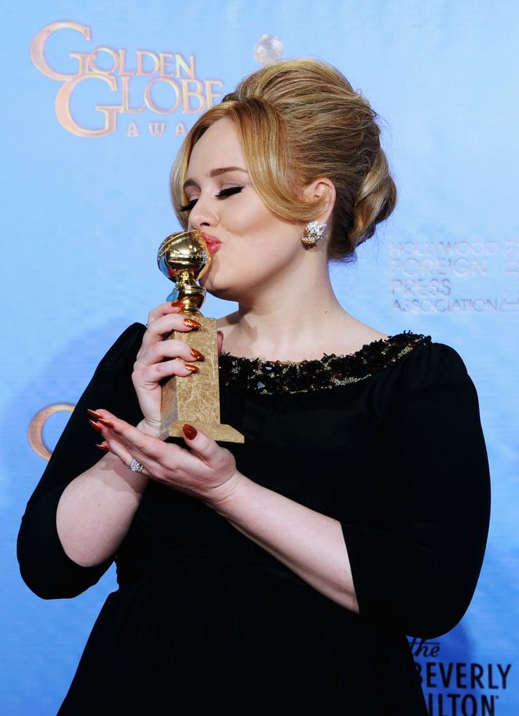 Adele kissed her Golden Globe for best original song.
