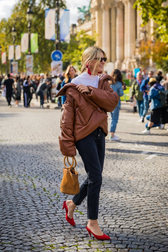 Camille Charrière shows us the most chic way to wear a puffer jacket.